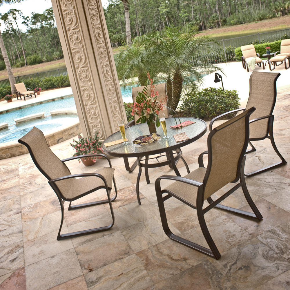 Woodard cayman isle sling round patio dining set wd for Woodard outdoor furniture